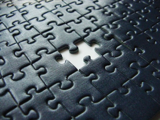 A black puzzle with a piece missing