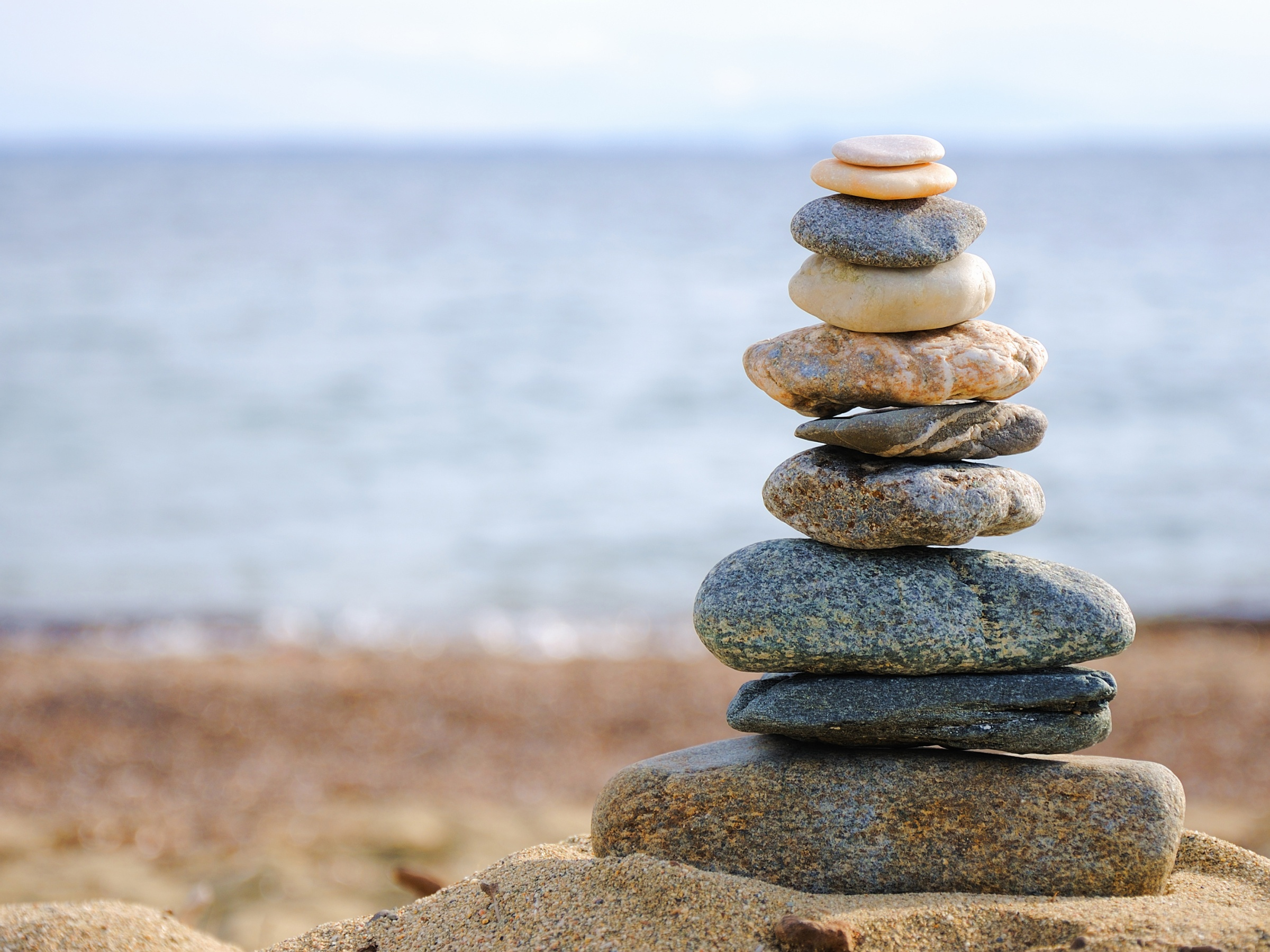 A pyramid of stones and pebbles balancing on one another