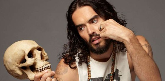 Russell Brand holding a skull