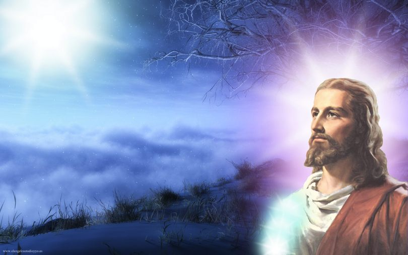 A picture of Jesus with light emanating from his head and a blue background
