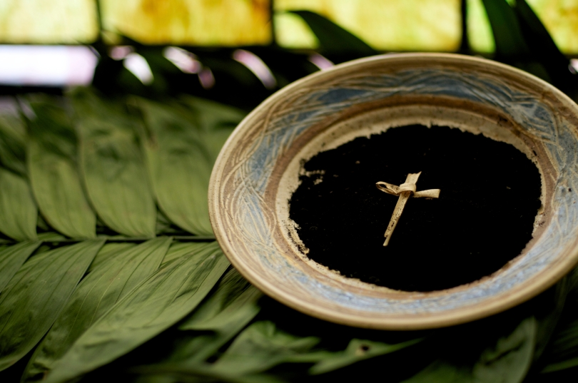A bowl full of ash and a cross