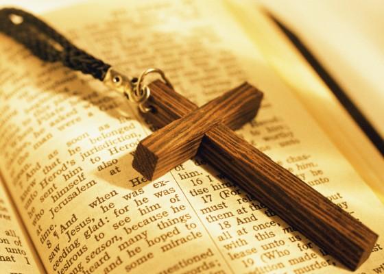 Wooden crucifix on open bible