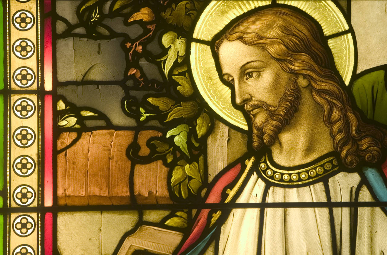 A stained glass depiction of Jesus