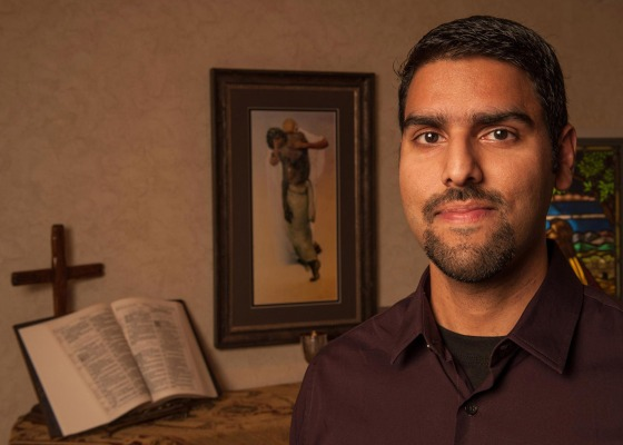 Nabeel Qureshi stood next to an open Bible