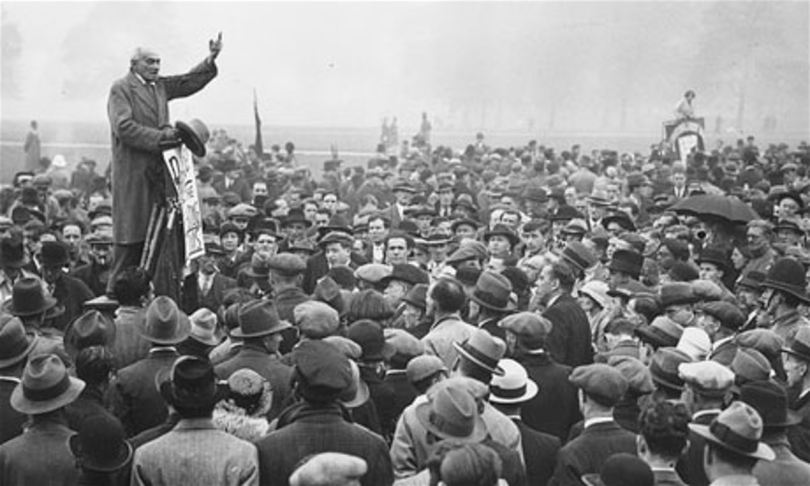 A black and white photo of a man speaking at Speakers' Corner in London