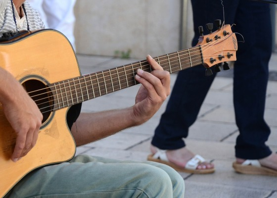 A man playing a guitar on the street