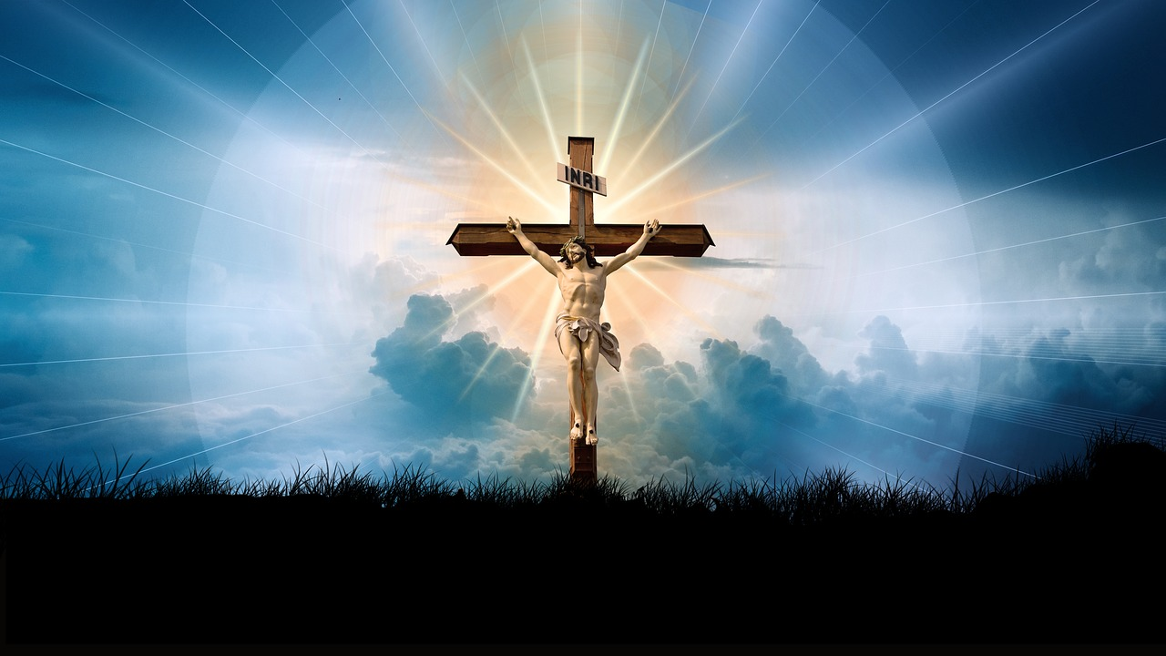 A depiction of Jesus on the cross with a bright light emanating from Him