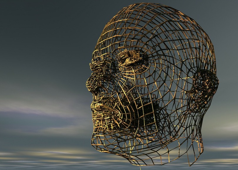A sculpture of a human head made with wire mesh