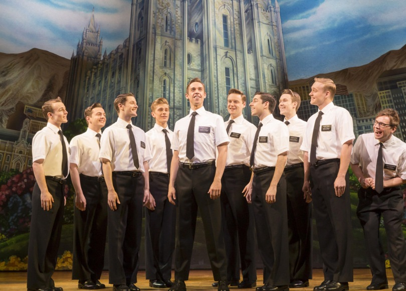 A group of actors on stage in a performance of The Book of Mormon