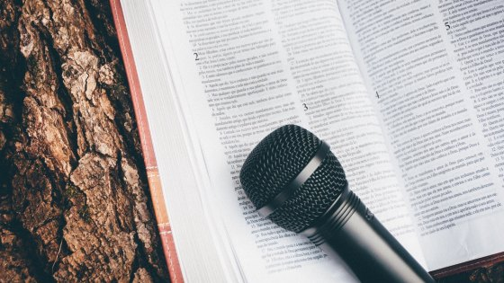 An open Bible with a microphone resting on it