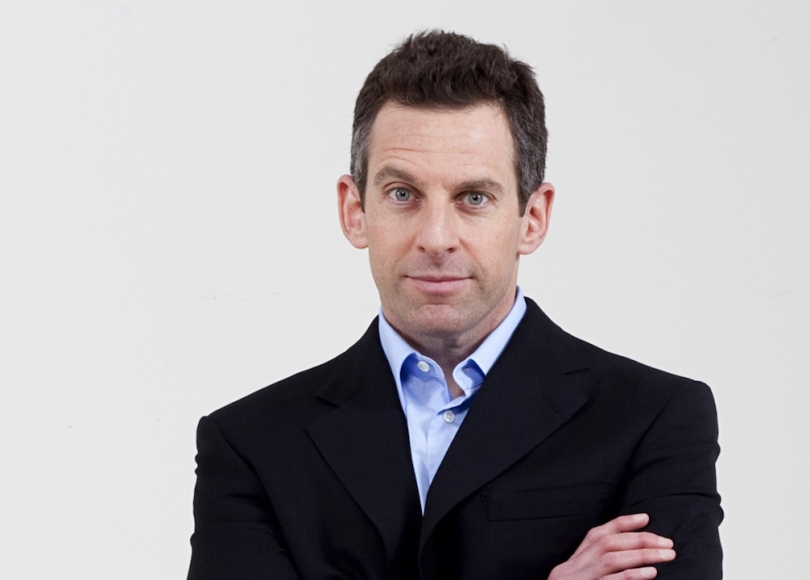 A portrait photo of Sam Harris wearing a suit