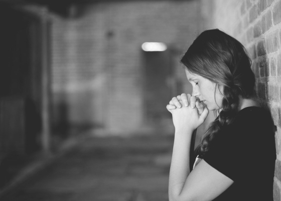 Woman in prayer black and white