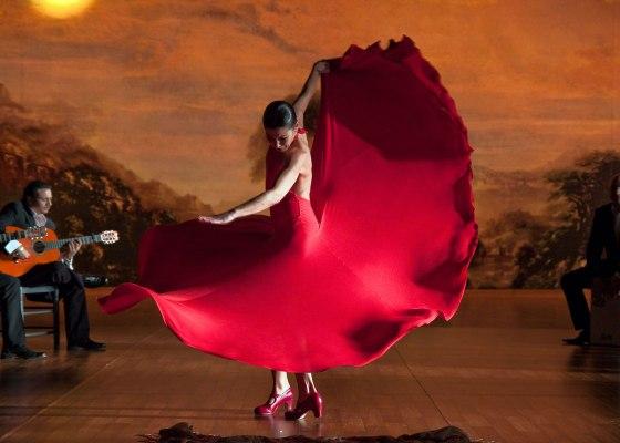 A woman dancing Flamenco