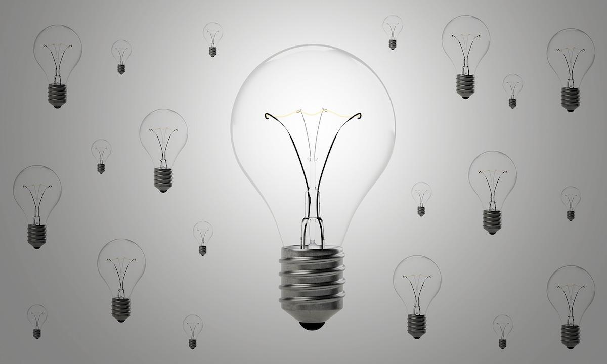Lightbulbs of varying sizes in a wallpaper pattern