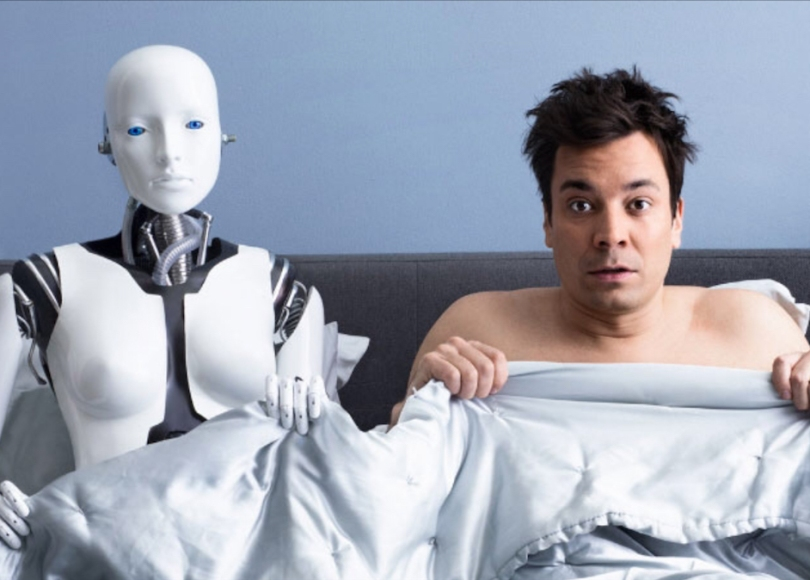 A man in bed with a robot