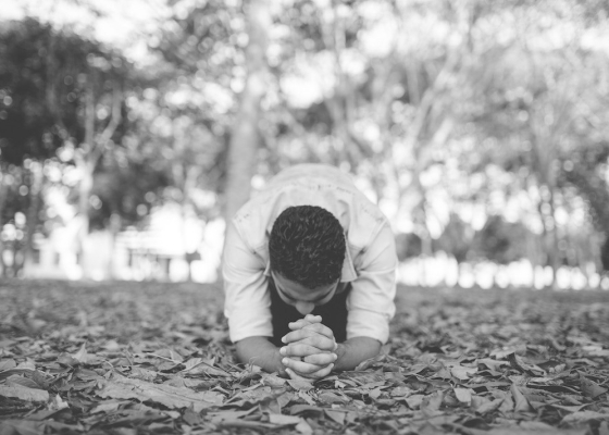 Man praying black and white