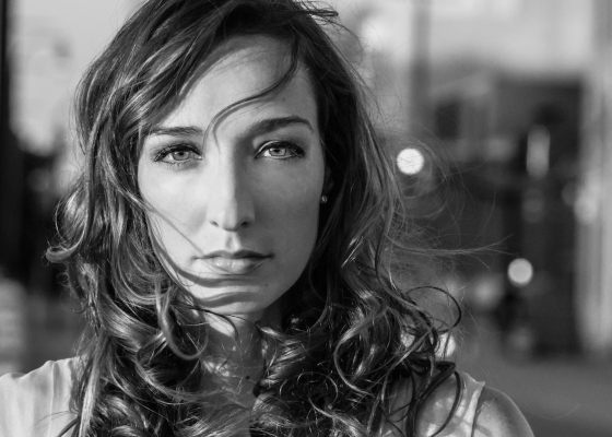 A black and white portrait photo of Jenn Bostic
