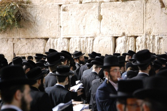 Jews praying by the wailing wall in Jerusalem