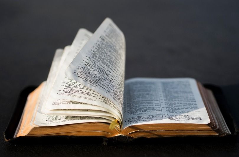 An open Bible with the pages shuffling