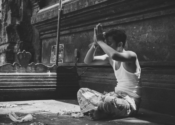 Boy praying black and white