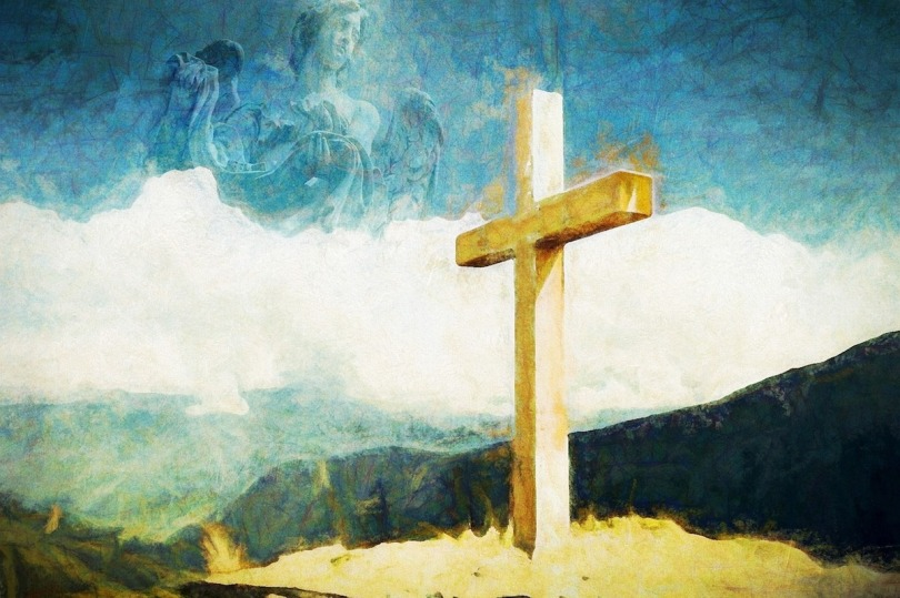 A cross on a hilltop with a painted background