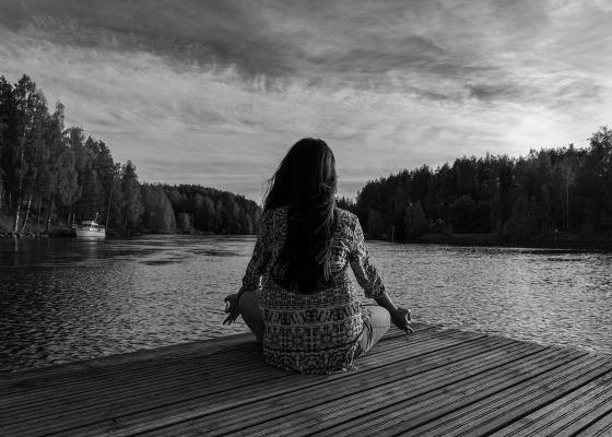 Girl meditating black and white