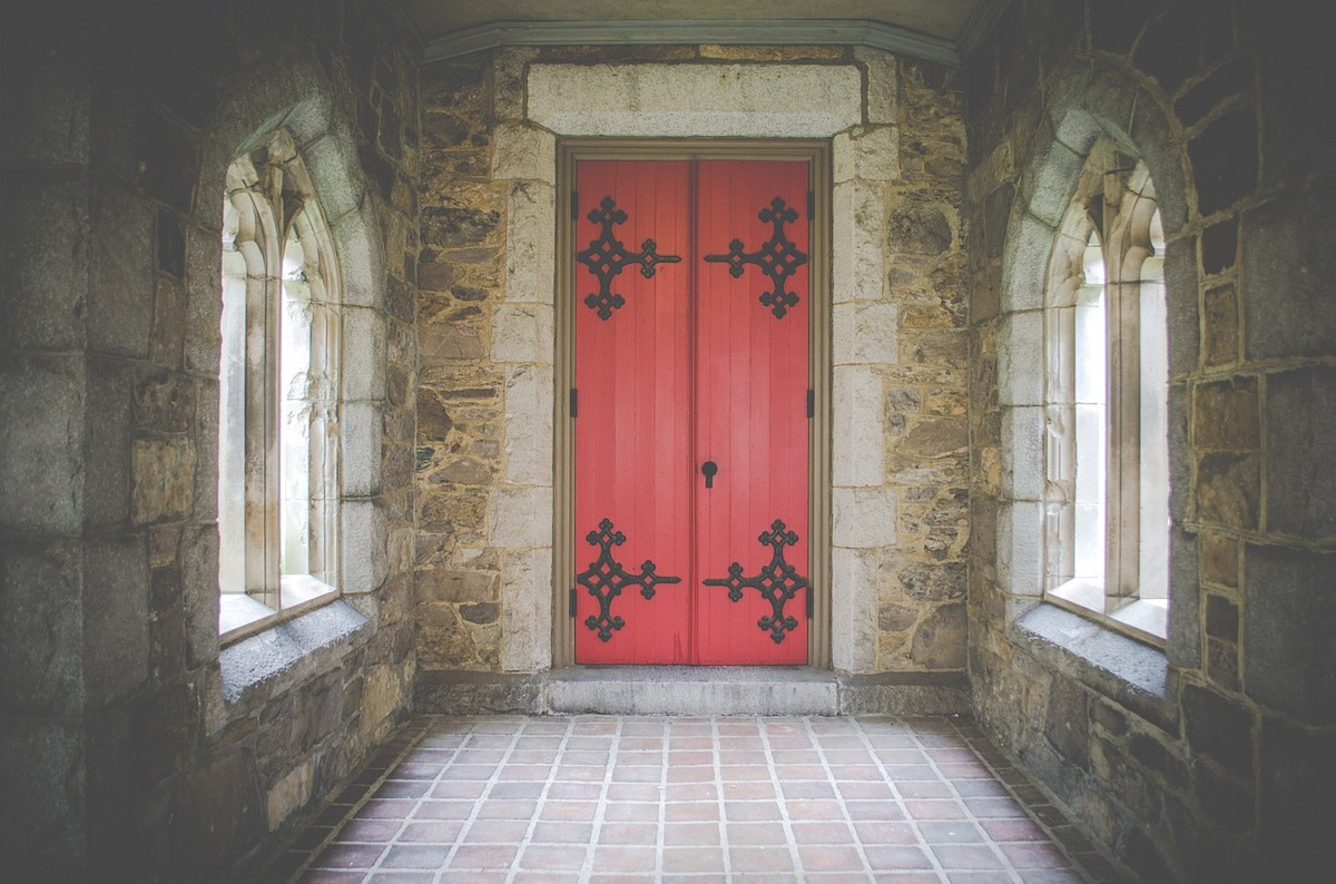 A red door inside a church building