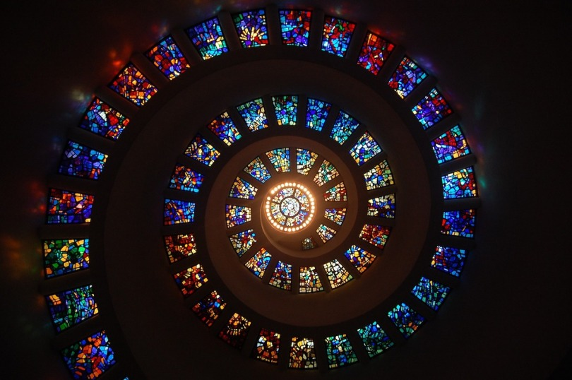 Colourful stained glass windows in a spiral pattern