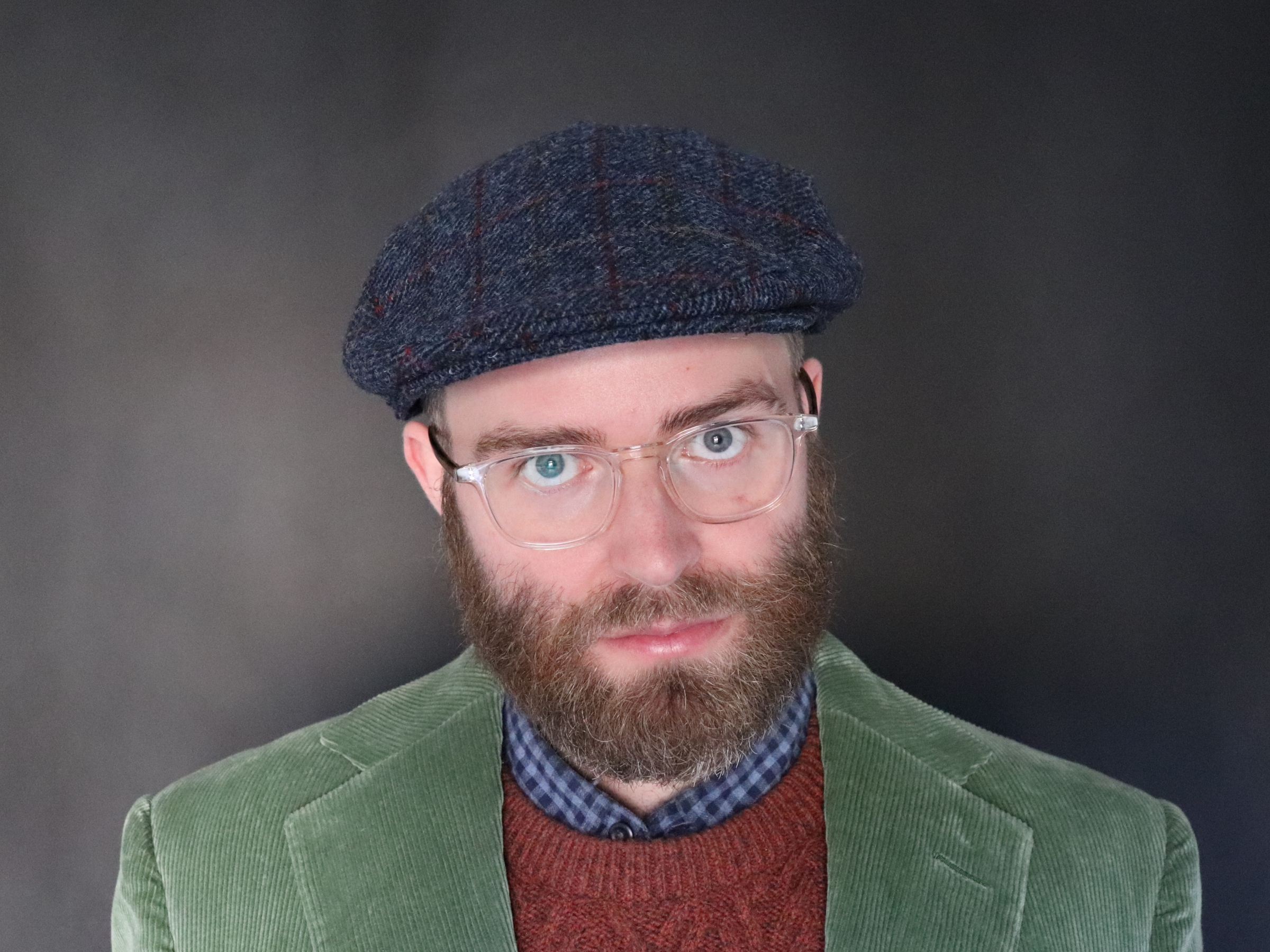 Steven Colborne in a green jacket and flat cap