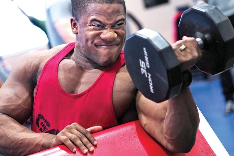 A muscular man lifting a weight