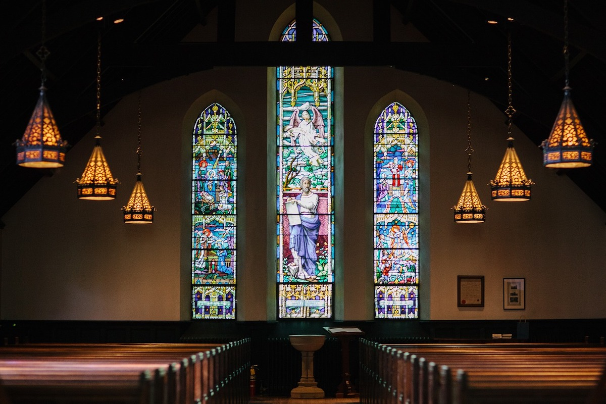 An empty church with stained glass windows