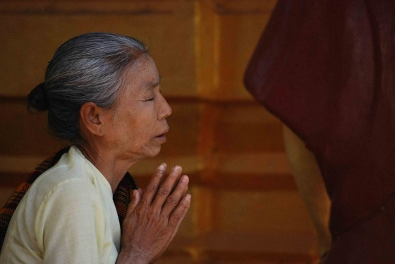 An older woman praying