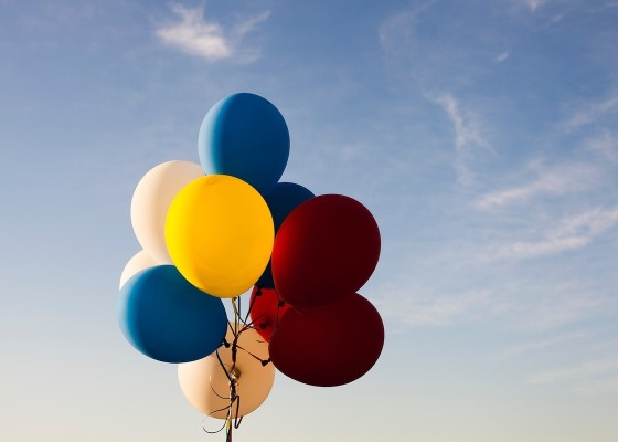 Balloons in from of a blue sky