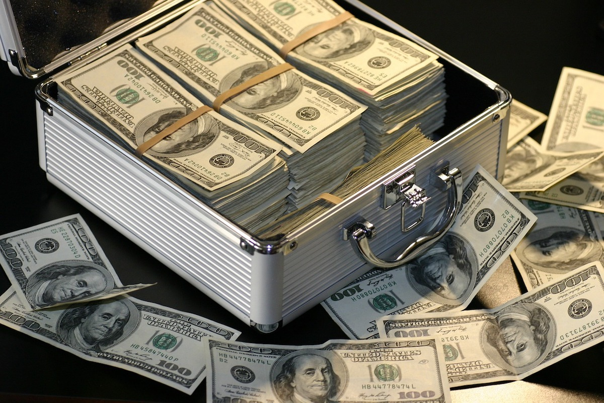 Large bundles of money in a metal case
