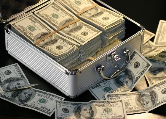 Large bundles of money in a metal case