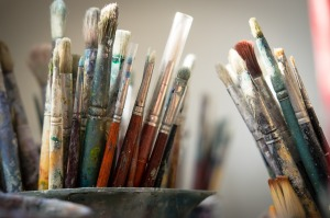 A large collection of well-used paint brushes