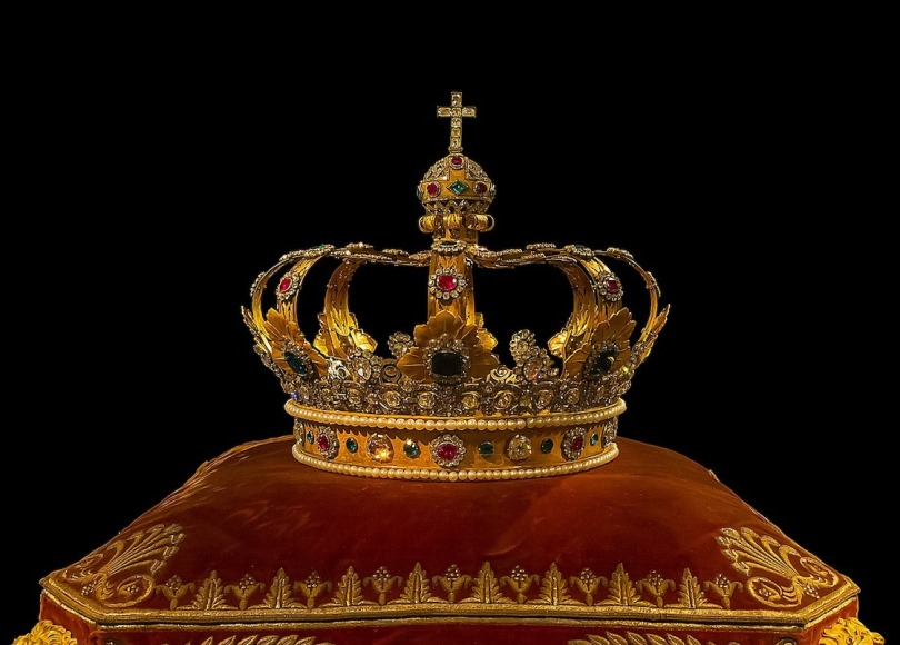 A gold crown on a cushion