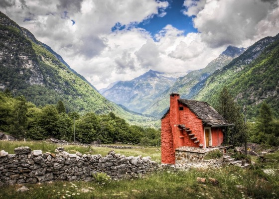 A red brick house in a valley