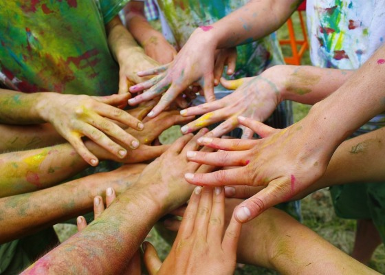 A group of people with paint on their hands