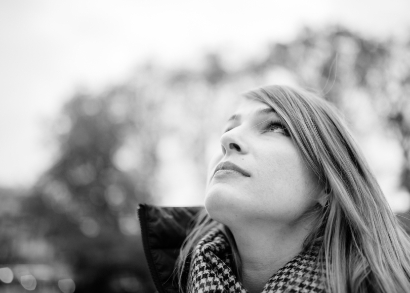 Girl looking up to heavens black and white