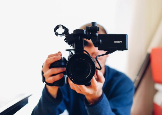 man holding a Sony camera