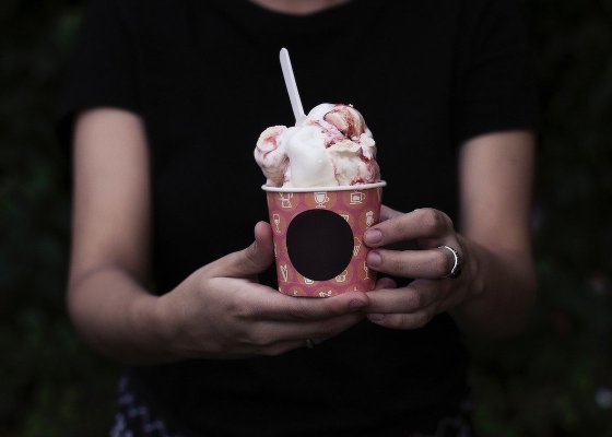 Woman holding a tub of ice cream