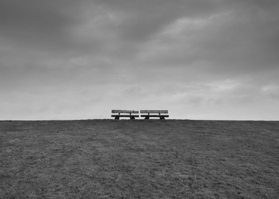 Two empty benches black and white