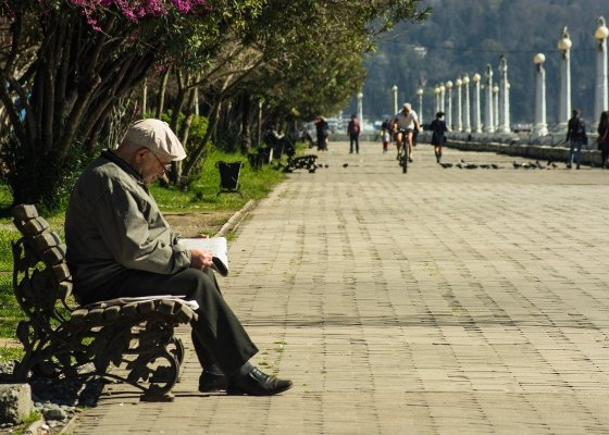 An elderly man sat on a bench