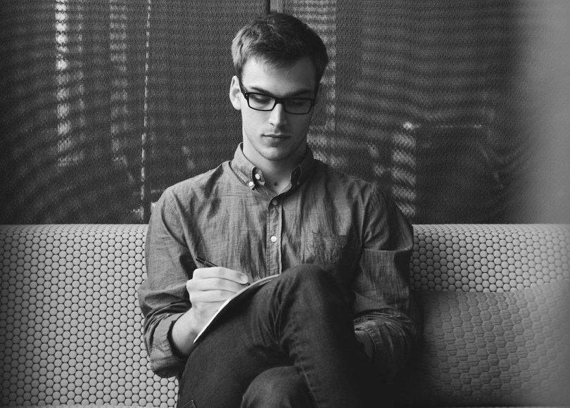 Man writing black and white