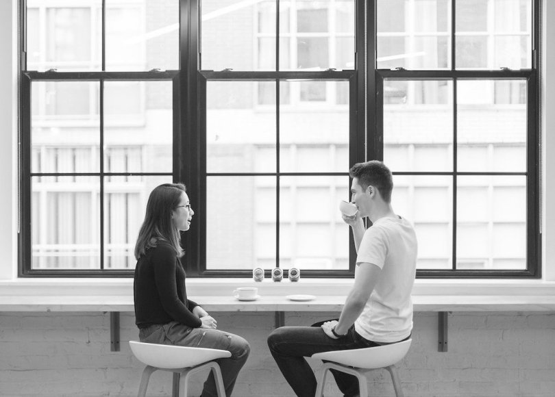 Man and woman chatting black and white