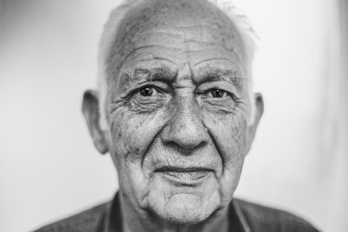 a black and white image of an old man