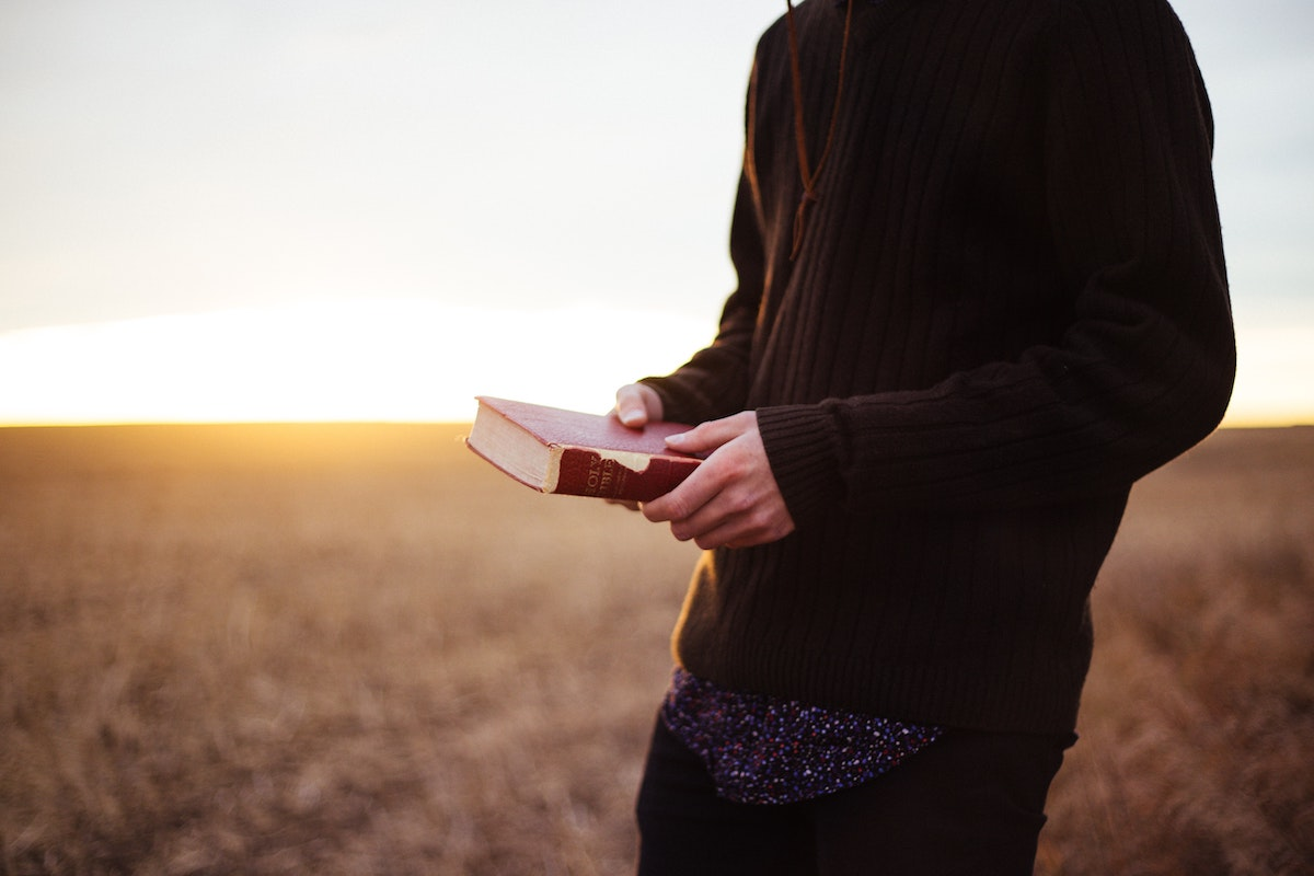 Person holding a Bible