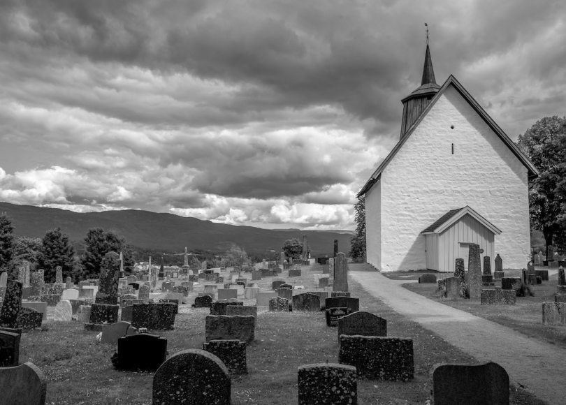Church and graveyard black and white