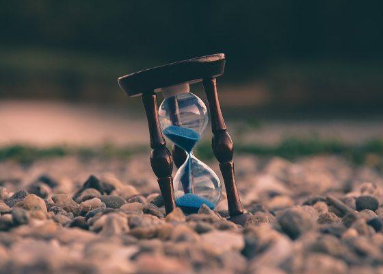 Hourglass on a stony ground